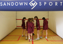 Inflatable fun as pupils learn to play squash