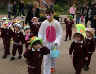 Nursery children parade colourful Easter bonnets