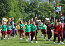 Year 2 girls and boys defy bad weather to shine at Summer Sports Festival